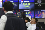 Currency traders work at the foreign exchange dealing room of the KEB Hana Bank headquarters in Seoul, South Korea, Tuesday, Feb. 11, 2020. Asian stock markets followed Wall Street higher on Tuesday, at least temporarily shaking off jitters about China's virus outbreak. (AP Photo/Ahn Young-joon)