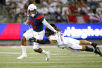 Arizona wide receiver Brian Casteel (5) tries to elude the tackle of Texas Tech defensive back Thomas Leggett (16) during the first half of an NCAA college football game, Saturday, Sept. 14, 2019, in Tucson, Ariz. (AP Photo/Ralph Freso)