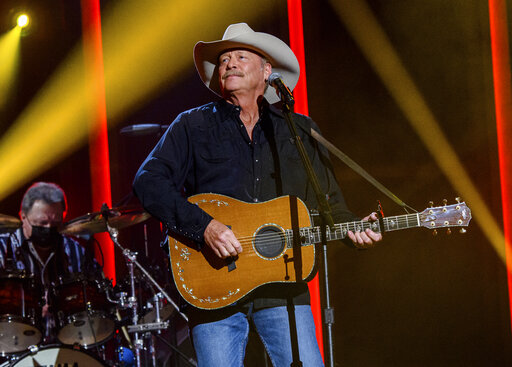 """FILE - Alan Jackson performs at the 56th annual Academy of Country Music Awards on  April 15, 2021 in Nashville, Tenn. Jackson revealed in a new interview that he has a degenerative nerve condition that has affected his balance. The 62-year-old Country Music Hall of Famer said in an interview on NBC's """"Today"""" show that he was diagnosed with Charcot-Marie-Tooth disease a decade ago. (Photo by Amy Harris/Invision/AP, File)"""