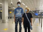 This July 2021 photo provided by China Aid shows Wang Jingyu, left, and his fiancee, Wu Huan, on their arrival at Schiphol airport in Amsterdam. The couple is on the run from the threat of extradition to China, and is now in the Netherlands seeking asylum. (China Aid via AP)