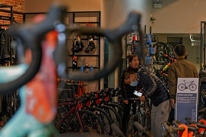 Customers wearing face masks to help curb the spread of the coronavirus look at the American bicycle brand at a retail shop in Beijing on March 2, 2021. U.S. and Chinese trade envoys talked by phone Thursday, May 27, 2021 for the first time since President Joe Biden took office, but the two sides gave no sign when negotiations on ending their tariff war might restart. (AP Photo/Andy Wong)