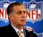 "File-This May 23, 2006 file photo shows then NFL Commissioner Paul Tagliabue responding to questions during a news conference at the conclusion of the National Football League's owners spring meeting in Denver. In 2003, the NFL had three minority head coaches: future Pro Football Hall of Famer Tony Dungy, Herman Edwards and Marvin Lewis. In the 12 previous seasons, there had been six. Total. Considering that the majority of the players in the league 16 years ago were minorities, that imbalance was enormous. And disturbing. And, frankly, it was unfair. Tagliabue, then the NFL commissioner, put together a committee that established the ""Rooney Rule,"" which requires all teams with coaching and front office vacancies to interview minority candidates. The rule, long overdue, was named for Dan Rooney, then president of the Pittsburgh Steelers and the overseer of that committee. (AP Photo/Ed Andrieski, File)"