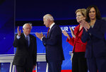 Sen. Bernie Sanders, I-Vt., left, takes the stage with, from left, former Vice President Joe Biden, Sen. Elizabeth Warren, D-Mass., and Sen. Kamala Harris, D-Calif., for the Democratic presidential primary debate hosted by ABC on the campus of Texas Southern University Thursday, Sept. 12, 2019, in Houston. (AP Photo/Eric Gay)