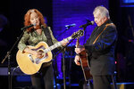 Bonnie Raitt, left, and John Prine perform during the Americana Honors & Awards show Wednesday, Sept. 11, 2019, in Nashville, Tenn. (AP Photo/Wade Payne)