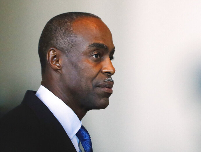"""FILE - In this Nov. 15, 2018 file photo, Broward County Public Schools Superintendent Robert Runcie appears before the Marjory Stoneman Douglas High School Public Safety Commission in Sunrise, Fla. The mother of a Marjory Stoneman Douglas High School shooting victim who is now on the county school board is pushing to have the Runcie fired, saying he """"has a history of leadership failures."""" Lori Alhadeff placed a measure on the Broward County school board agenda for Tuesday, March 5, 2019, calling for Runcie to be fired. Alhadeff's 14-year-old daughter Alyssa died in the Feb. 14, 2018, massacre. Alhadeff has the support of other families of the 14 students and three staff members killed.  (AP Photo/Brynn Anderson, File)"""