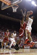Indiana's Juwan Morgan (13) puts up a shot against Arkansas's Adrio Bailey (2) during the second half in the second round of the NIT college basketball tournament, Saturday, March 23, 2019, in Bloomington, Ind. Indiana won 63-60. (AP Photo/Darron Cummings)