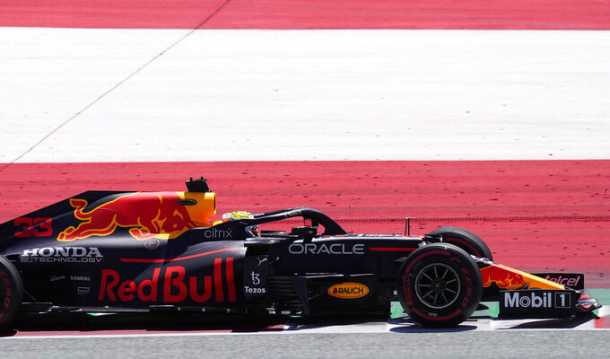 Red Bull driver Max Verstappen of the Netherlands steers his car during the third free practice session for the Austrian Formula One Grand Prix at the Red Bull Ring racetrack in Spielberg, Austria, Saturday, July 3, 2021. The Austrian Grand Prix will be held on Sunday. (AP Photo/Darko Bandic)