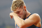 Kevin Mayer, of France, wipes his face after pulling out of the the men's decathlon pole vault competition because of an injury at the World Athletics Championships in Doha, Qatar, Thursday, Oct. 3, 2019. (AP Photo/Hassan Ammar)