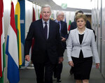 European Union chief Brexit negotiator Michel Barnier, left, walks with Scotland's First Minister Nicola Sturgeon prior to a meeting at EU headquarters in Brussels Tuesday, June 11, 2019. (Olivier Hoslet, Pool Photo via AP)