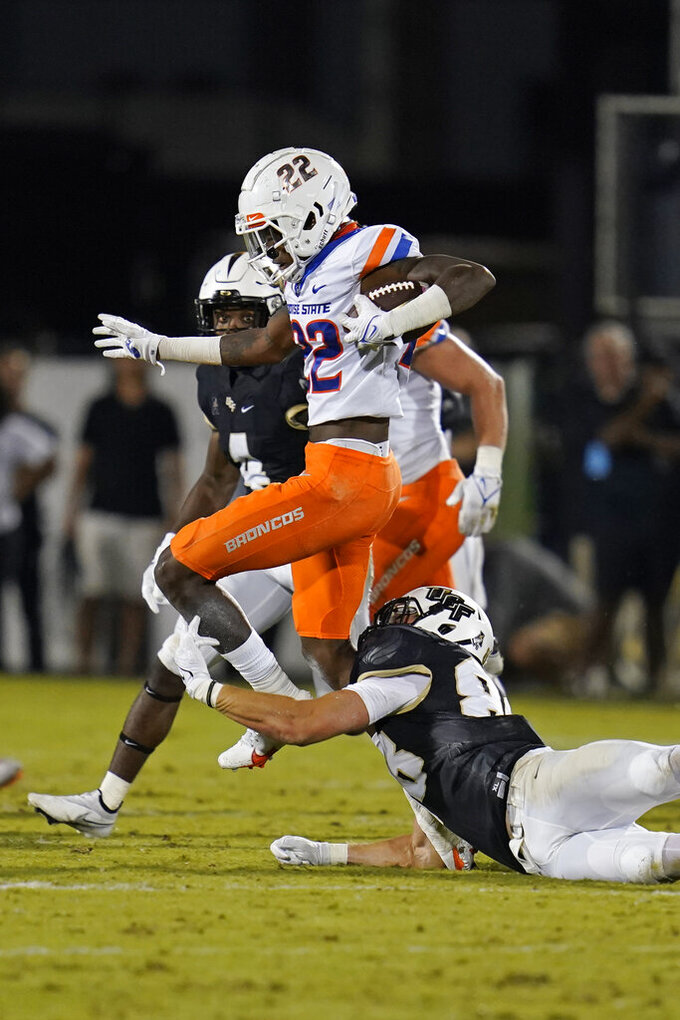 Boise State cornerback Tyric LeBeauf (22) runs back an interception, trying to get past Central Florida tight end Jake Hescock during the second half of an NCAA college football game early Friday, Sept. 3, 2021, in Orlando, Fla. (AP Photo/John Raoux)
