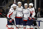 Washington Capitals' John Carlson, second from left, celebrates his goal with teammates Michal Kempny (6), Travis Boyd, second from right, and Carl Hagelin (62) during the first period of an NHL hockey game against the Los Angeles Kings Wednesday, Dec. 4, 2019, in Los Angeles. (AP Photo/Marcio Jose Sanchez)