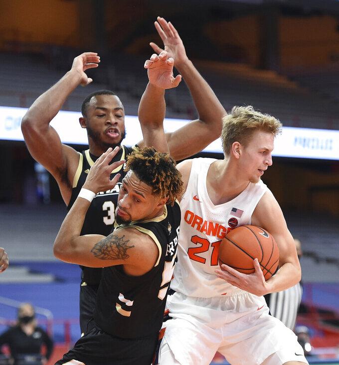 Syracuse forward Marek Dolezaj (21) pulls the ball from Bryant guard Charles Pride (5) during the first half of an NCAA college basketball game, Friday, Nov. 27, 2020, in Syracuse, N.Y. (Dennis Nett/The Post-Standard via AP)