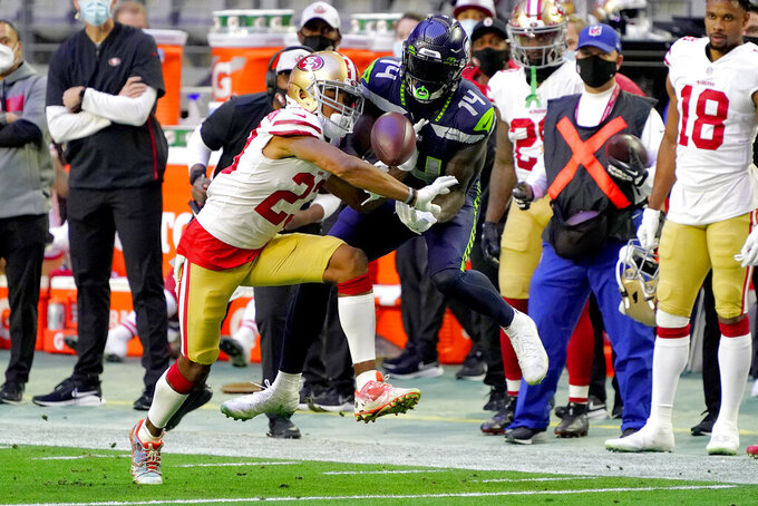 San Francisco 49ers cornerback Ahkello Witherspoon breaks up a pass intended for Seattle Seahawks wide receiver DK Metcalf (14) during the second half of an NFL football game, Sunday, Jan. 3, 2021, in Glendale, Ariz. (AP Photo/Rick Scuteri)