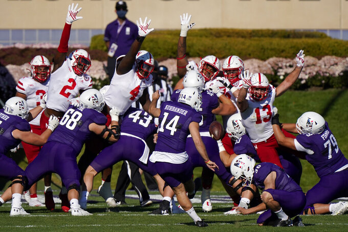 Northwestern kicker Charlie Kuhbander (14) kicks a field goal during the second half of an NCAA college football game against Nebraska in Evanston, Ill., Saturday, Nov. 7, 2020. Northwestern won 21-13. (AP Photo/Nam Y. Huh)