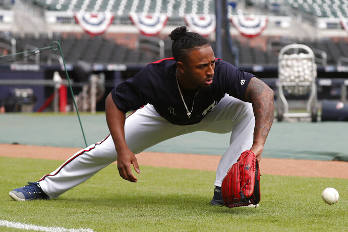 Atlanta Braves second baseman Ozzie Albies (1) works on his fielding skills during a baseball practice Tuesday, Oct. 8, 2019, in Atlanta. The Braves will face the St. Louis Cardinals in Game 5 of the NLCS Wednesday in Atlanta. (AP Photo/John Bazemore)