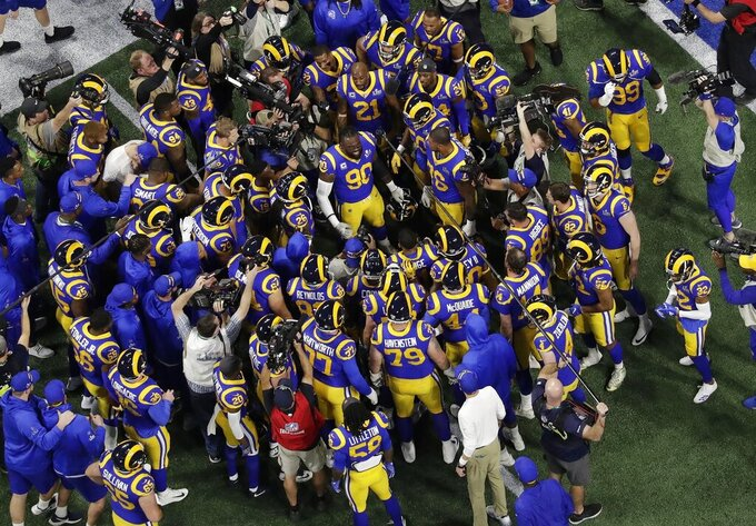 Los Angeles Rams' Michael Brockers (90) rallies teammates before the NFL Super Bowl 53 football game between the Los Angeles Rams and the New England Patriots, Sunday, Feb. 3, 2019, in Atlanta. (AP Photo/Morry Gash)