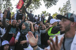 Teachers chant slogans during a demonstration in Rabat, Morocco, Wednesday, Feb. 20, 2019. Moroccan police fired water cannons at protesting teachers who were marching toward a royal palace and beat people with truncheons amid demonstrations around the capital Wednesday. (AP Photo/Mosa'ab Elshamy)