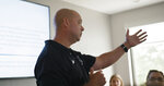 In this July 17, 2019 photo provided by Market Mentors, LLC, Steven Grasso from Protective Advanced Safety Services (PASS) speaks during an active shooter training at the Market Mentors office in Springfield, Mass. (Justin Bedard/Market Mentors, LLC via AP)