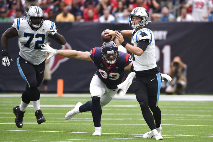 Carolina Panthers quarterback Kyle Allen (7) is pressured by Houston Texans defensive end J.J. Watt (99) during the first half of an NFL football game Sunday, Sept. 29, 2019, in Houston. (AP Photo/Eric Christian Smith)