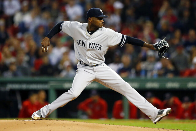 FILE  - In this Sept. 6, 2019, file photo, New York Yankees' Domingo German pitches during the first inning of the team's baseball game against the Boston Red Sox in Boston. Yankees pitcher Domingo German was reinstated from the restricted list by the commissioner's office on Tuesday, Oct. 6, 2020, after completing an 81-game suspension under Major League Baseball's domestic violence policy. The 28-year-old right-hander is not eligible to pitch in the postseason because he was on the restricted list on Sept. 15, the last date for postseason eligibility. He will be eligible to pitch next year.(AP Photo/Michael Dwyer, File)