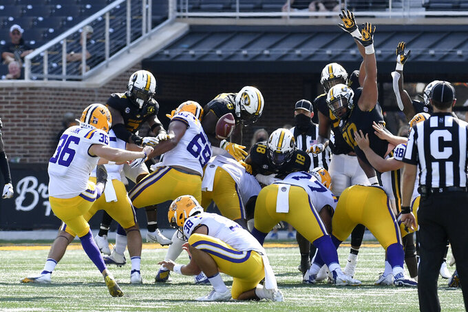 Members of the Missouri defense block a field goal attempt by LSU place kicker Cade York (36) during the second half of an NCAA college football game Saturday, Oct. 10, 2020, in Columbia, Mo. Missouri upset LSU 45-41. (AP Photo/L.G. Patterson)