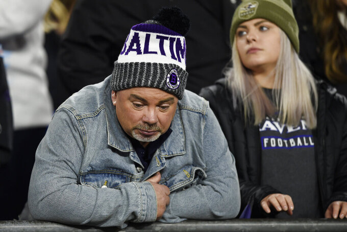 Baltimore Ravens fans stand in the stands during the second half of an NFL divisional playoff football game between the Baltimore Ravens and the Tennessee Titans, Saturday, Jan. 11, 2020, in Baltimore. (AP Photo/Gail Burton)