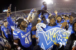Memphis players celebrate after defeating Cincinnati in an NCAA college football game for the American Athletic Conference championship Saturday, Dec. 7, 2019, in Memphis, Tenn. (AP Photo/Mark Humphrey)