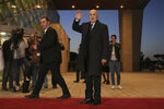 Algerian presidential candidate Abdelmadjid Tebboune arrives for televised debate in Algiers, Friday, Dec. 6, 2019. Restive Algeria is holding its first - and sole - televised presidential debate ahead of the consequential Dec. 12 poll. Five all-male candidates - Azzedine Mihoubi, Abdelmadjid Tebboune, Abdelkader Bengrina, Ali Benflis et Abdelaziz Belaid - are vying to make their case Friday evening to lead the North African country. (AP Photo/Fateh Guidoum)