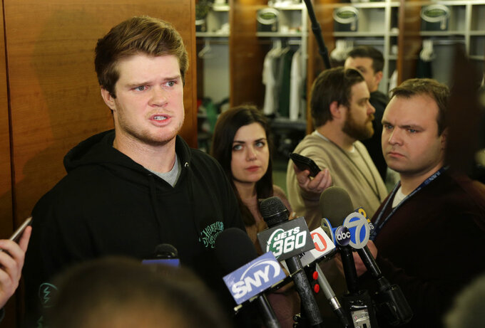 New York Jets quarterback Sam Darnold talks to reporters in the locker room in Florham Park, N.J., Monday, Dec. 31, 2018. The search for a new coach has begun for the New York Jets. After firing Todd Bowles on Sunday night, the team is focused on bringing in someone who will be able to lead a franchise that has missed the playoffs for eight straight seasons but has a promising young quarterback in Darnold and expects to be busy in free agency this offseason.(AP Photo/Seth Wenig)