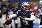 Dallas Cowboys quarterback Dak Prescott (4) throws during the first half of an NFL football game against the Los Angeles Chargers Sunday, Sept. 19, 2021, in Inglewood, Calif. (AP Photo/Gregory Bull )