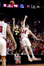Iowa's Jordan Bohannon (3) tries for three points but misses against Nebraska's Thorir Thorbjarnarson (34) with 1.6 seconds in overtime of an NCAA college basketball game in Lincoln, Neb., Sunday, March 10, 2019. in overtime. (AP Photo/Nati Harnik)