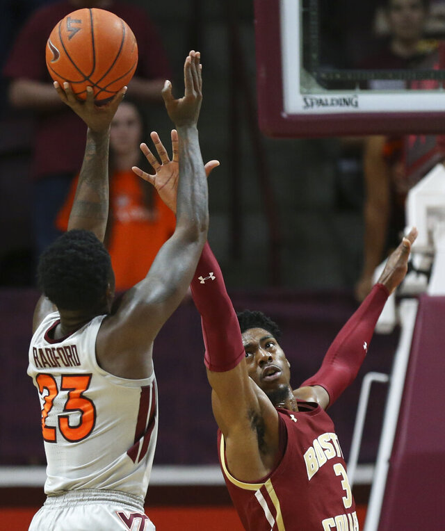 Virginia Tech's Tyrece Radford (23) shoots over Boston College's Jared Hamilton (3)  during the first half of an NCAA college basketball game, Saturday, Feb. 8 2020, in Blacksburg Va. (Matt Gentry/The Roanoke Times via AP)