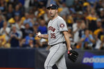 Houston Astros starting pitcher Justin Verlander walks back to the mound after giving up a walk in the second inning of Game 4 of the baseball team's American League Division Series against the Tampa Bay Rays, Tuesday, Oct. 8, 2019, in St. Petersburg, Fla. (AP Photo/Scott Audette)