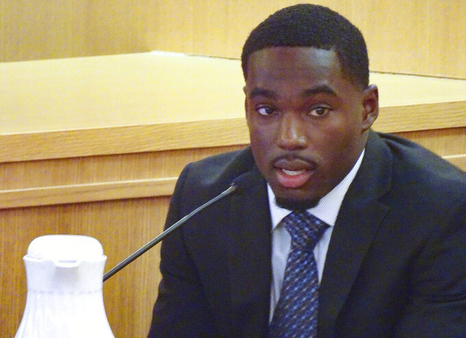 FILE - In this Aug. 2, 2019, file photo, former Wisconsin football player Quintez Cephus testifies during his trial in Madison, Wis.  Cephus says going back to school is his top priority after a jury found him not guilty last week of sexual assault charges. The wide receiver tells the Milwaukee Journal Sentinel in a story published Tuesday, Aug. 6 that he doesn't know if he will return to the University of Wisconsin or another college. (Ed Treleven/Wisconsin State Journal via AP, File)