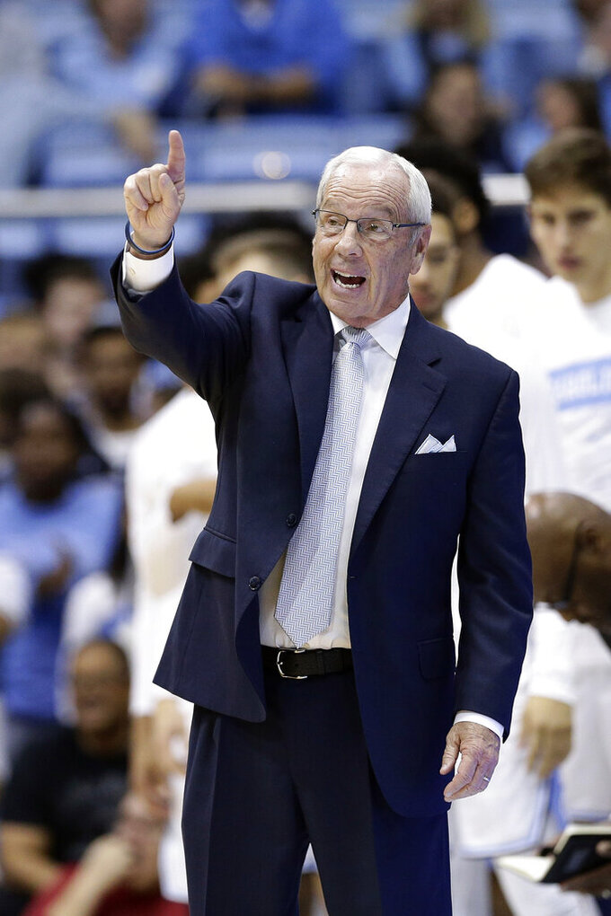 North Carolina head coach Roy Williams reacts during the first half of an NCAA college basketball game against the Notre Dame in Chapel Hill, N.C., Wednesday, Nov. 6, 2019. (AP Photo/Gerry Broome)