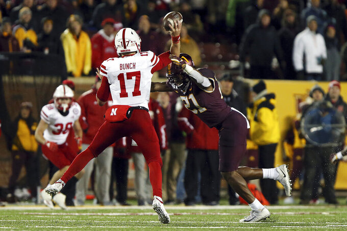 Minnesota linebacker Kamal Martin (21) sacks Nebraska quarterback Andrew Bunch (17) during the second half of an NCAA college football game Saturday, Oct. 12, 2019, in Minneapolis. (AP Photo/Stacy Bengs)