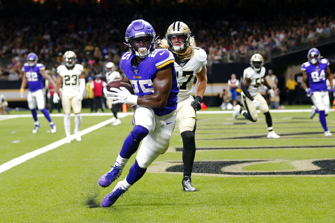 Minnesota Vikings running back Alexander Mattison (25) pulls in a touchdown reception in front of New Orleans Saints middle linebacker Alex Anzalone (47) in the first half of an NFL preseason football game in New Orleans, Friday, Aug. 9, 2019. (AP Photo/Gerald Herbert)