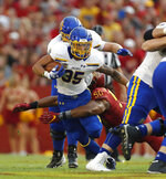 South Dakota State running back Isaac Wallace, left, is taken down by Iowa State defensive end Eyioma Uwazurike during the first half of an NCAA college football game, Saturday, Sept. 1, 2018, in Ames, Iowa. (AP Photo/Matthew Putney)