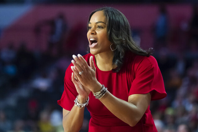 """File-This Nov. 17, 2019, file photo shows Georgia coach Joni Taylor shouting to players during an NCAA women's basketball game against Georgia Tech in Athens, Ga. The Georgia Lady Bulldogs are back in the Top 25. """"That's a part of Georgia basketball. That's the expectation,"""" coach Joni Taylor said Tuesday."""