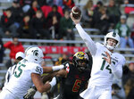 Michigan State quarterback Brian Lewerke, right, throws against the Maryland defense in the first half of an NCAA college football game, Saturday, Nov. 3, 2018, in College Park, Md. (AP Photo/Gary Cameron)