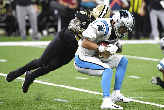 New Orleans Saints outside linebacker Demario Davis (56) sacks Carolina Panthers quarterback Kyle Allen (7), during the first half at an NFL football game, Sunday, Nov. 24, 2019, in New Orleans. (AP Photo/Bill Feig)
