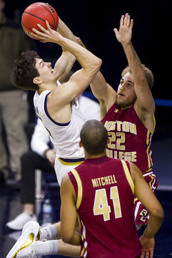 Notre Dame's Cormac Ryan, left, goes up to shoot over Boston College's Rich Kelly (22) and Steffon Mitchell (41) during the first half of an NCAA college basketball game Saturday, Jan. 16, 2021, in South Bend, Ind. (AP Photo/Robert Franklin)