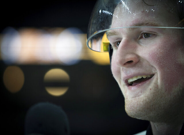 FILE - In this Jan. 16, 2020, file photo, Team White left winger Alexis Lafreniere smiles following hockey's CHL Top Prospects Game in Hamilton, Ontario. The New York Rangers liked the improvement they showed before the pandemic interrupted last season. They were not happy with their quick exit in postseason, but the disappointment was soothed when they won the No. 1 pick in the NH draft, and selected touted forward Lafreniere. (Peter Power/The Canadian Press via AP, File)
