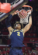 Michigan guard Jordan Poole dunks the ball during the first half of an NCAA college basketball game against Rutgers Tuesday, Feb. 5, 2019, in Piscataway, N.J. (AP Photo/Bill Kostroun)