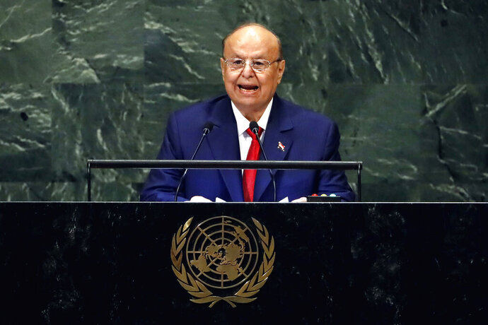FILE - In this Sept. 26, 2018 file photo, Yemen's President Abed Rabbo Mansour Hadi addresses the 73rd session of the United Nations General Assembly, at U.N. headquarters. Yemeni officials say heavy fighting in Yemen's southern Dhale province between pro-government forces and Shiite rebels has killed more than 85 people. The officials say the Houthi rebels recaptured the district of Damt and the surrounding area from forces allied with the internationally recognized government after more than a week of fighting. They say dozens have been wounded. Yemen has been embroiled in a civil war pitting the Iran-backed Houthis against the government of President Abed Rabbo Mansour Hadi, backed by a Saudi-led coalition since March 2015. (AP Photo/Richard Drew, File)