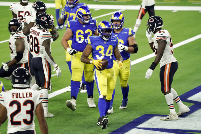Los Angeles Rams' Malcolm Brown (34) scores a touchdown during the second half of an NFL football game against the Chicago Bears Monday, Oct. 26, 2020, in Inglewood, Calif. (AP Photo/Ashley Landis)