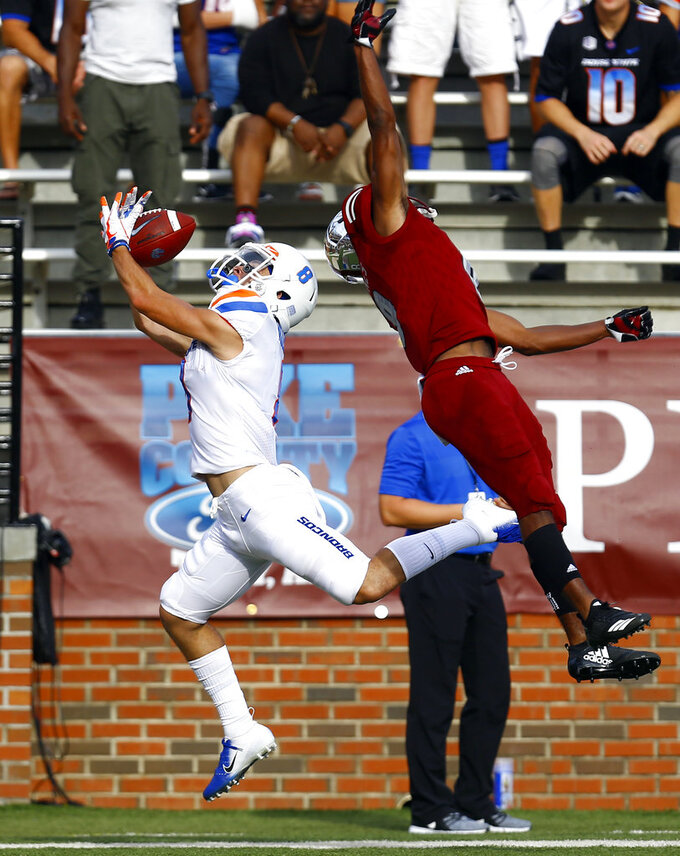 Boise State wide receiver Sean Modster, left, catches a pass for a touchdown as Troy cornerback Marcus Jones, right, tries to defend during the first half of an NCAA college football game, Saturday, Sept. 1, 2018, in Troy, Ala. (AP Photo/Butch Dill)