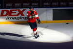 Florida Panthers center Aleksander Barkov is awarded the first star of the game after scoring in overtime of the team's NHL hockey game against the Carolina Hurricanes, Saturday, April 24, 2021, in Sunrise, Fla. (AP Photo/Joel Auerbach)
