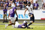 TCU safety T.J. Carter (7) and linebacker Wyatt Harris (25) attempt to stop California quarterback Chase Garbers (7) as he carries the ball in the second half of an NCAA college football game in Fort Worth, Texas, Saturday, Sept. 11, 2021. (AP Photo/Tony Gutierrez)
