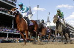Florent Geroux, left, celebrates as he rides Monomoy Girl to victory as Joe Bravo, center, atop Blue Prize and Jose Ortiz, right, atop Wow Cat follow in the Breeders' Cup Distaff horse race at Churchill Downs, Saturday, Nov. 3, 2018, in Louisville, Ky. (AP Photo/Darron Cummings)